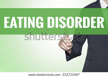 Eating Disorder word on green virtual screen touching by business woman - stock photo