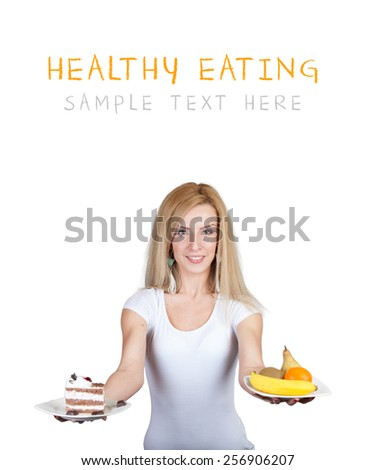 Eating fruit and vegetable or Sweets Cake and Candy - Beautiful young woman with two plates full of healthy and unhealthy food  - Weight loss diet - Isolated on white with place for your text - stock photo