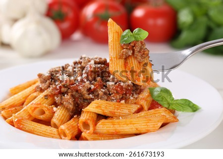 Eating pasta Bolognese or Bolognaise sauce noodles meal on a plate - stock photo