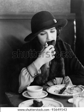 EATING TO FORGET - stock photo