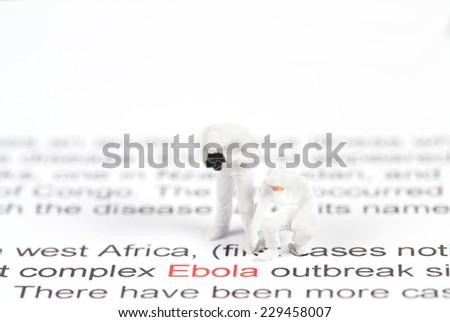 Ebola concept : Scientist in protective Hazmat Suit find word ebola. - stock photo