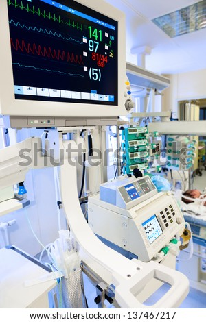 ECG monitor in neonatal intensive care unit - stock photo