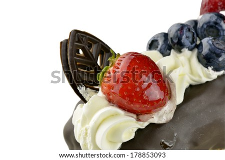 Eclair with chocolate strawberry and blueberries  - stock photo