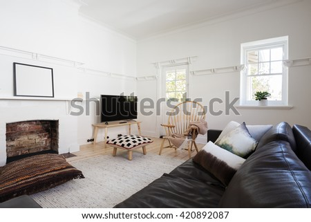 Eclectic styled contemporary living room in older spacious Melbourne apartment - stock photo