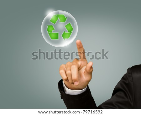 Eco concept : Business hand point recycling symbol in bubble - stock photo