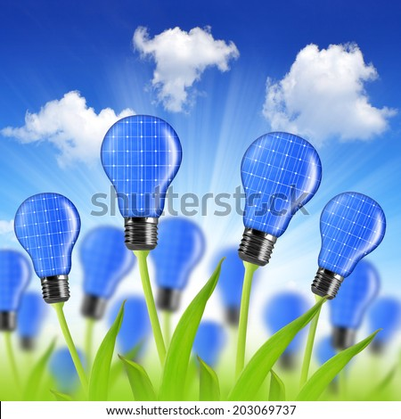 eco energy bulbs from solar panels - stock photo