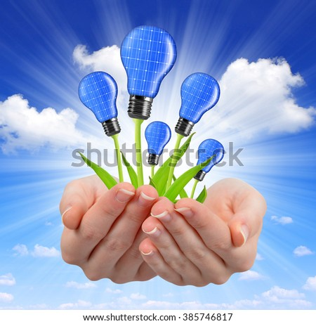 Eco energy light bulbs in hands - stock photo