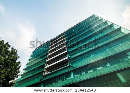 Eco energy saving building structure with glass exterior - stock photo