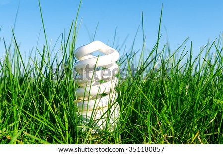 eco friendly bulb in green grass - stock photo