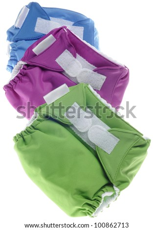 Eco Friendly Cloth Diapers in Green, Purple and Blue Isolated on White. - stock photo