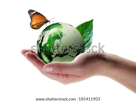 eco-friendly concept - butterfly on planet in hand -  Elements of this image furnished by NASA   - stock photo
