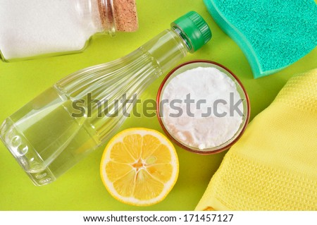 Eco-friendly natural cleaners. Vinegar, baking soda, salt, lemon and cloth. Homemade green cleaning. - stock photo