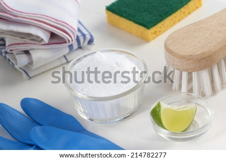 Eco-friendly natural cleaners Vinegar, baking soda, salt, lemon and cloth on wooden table Homemade green cleaning - stock photo