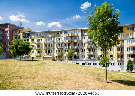 Eco friendly newly built block of flats in green nature - stock photo