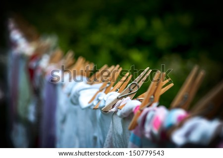 Eco-friendly - washing line, clothes and pegs. - stock photo