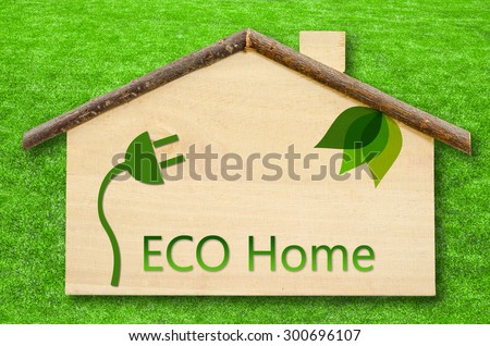 Eco home on Little home wooden model on green grass background. Save clipping path - stock photo