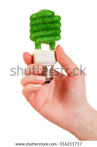 Eco light bulb in hand isolated on white background - stock photo