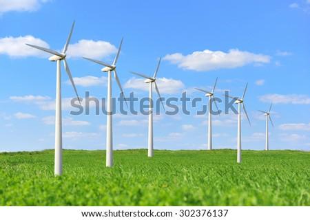 Eco power. Wind turbines generating electricity - stock photo