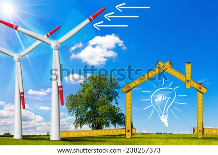 Ecologic House - Wind Energy Concept. Wooden yellow meter tool forming a ecologic house with wind energy turbine power station - stock photo