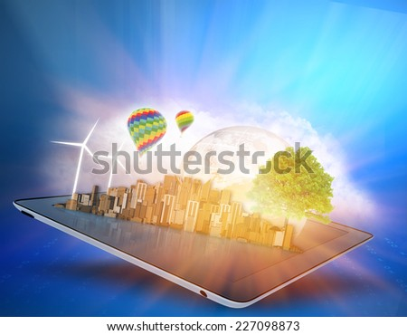 ecological city with clouds and windmills on the tablet - stock photo
