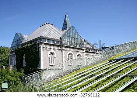 Ecological modern building of library. Warsaw University in Poland. - stock photo