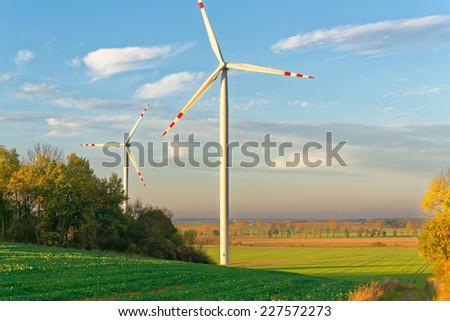 Ecological windmills over Polish landscape - stock photo