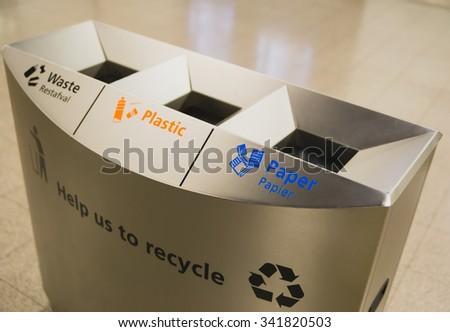 Ecology container recycling bins at the airport - stock photo