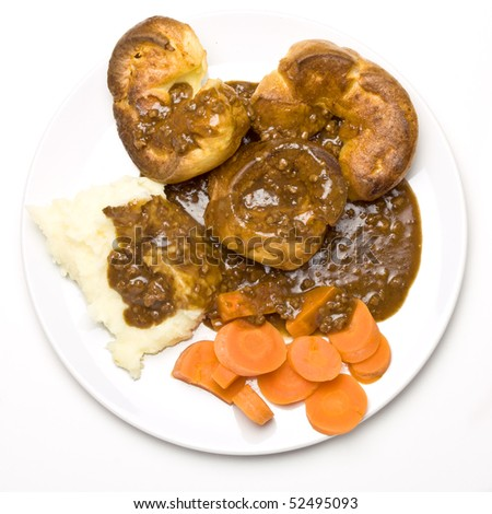 Economic Dinner of mince, mashed potato, carrots and yorkshire puddings. - stock photo