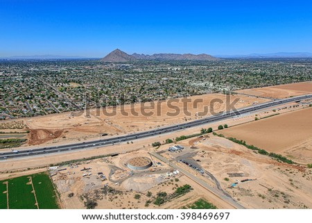 Economic growth and construction in Scottsdale, Arizona along the Loop 101 freeway as viewed from above - stock photo
