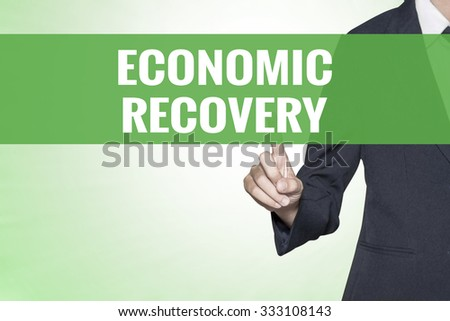Economic Recovery word on green virtual screen touching by business woman - stock photo