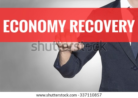 Economy Recovery word Business man touching on red tab virtual screen for business concept - stock photo