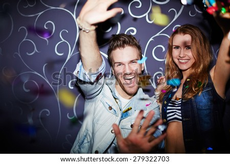 Ecstatic couple having fun at party - stock photo