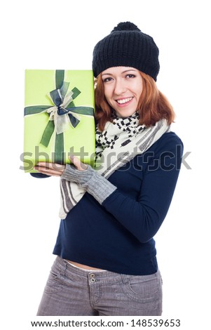 Ecstatic happy winter woman holding present, isolated on white background. - stock photo
