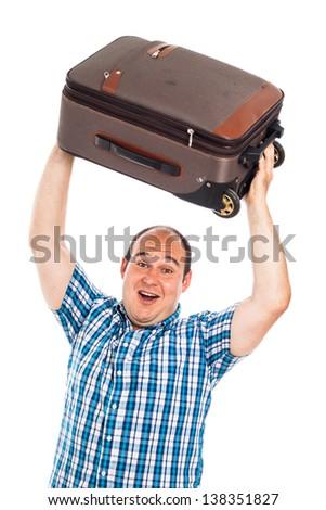 Ecstatic passenger man lifting up his luggage, isolated on white background - stock photo