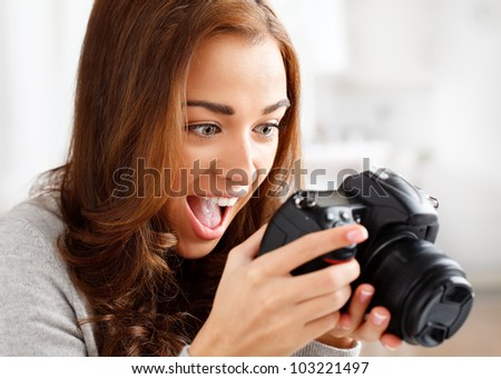 ecstatic photographer looking at photo - stock photo