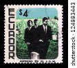 Ecuador - CIRCA 1969: A stamp printed in Ecuador shows image of Martin Luther King, John Fitzgerald Kennedy and Robert Fitzgerald Kennedy, against the background of Memorial Cemetery, circa 1969 - stock photo