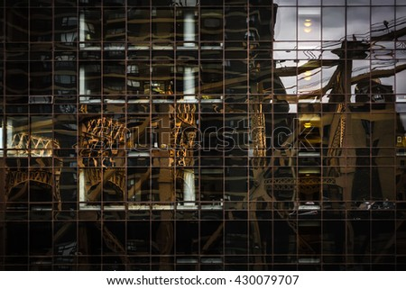Ed Koch Queensboro Bridge reflection in the glass surface of a modern building in Manhattan - stock photo