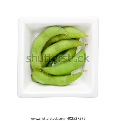 Edamame beans in a square bowl isolated on white background - stock photo