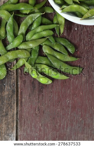 Edamame soy beans on wood background. - stock photo
