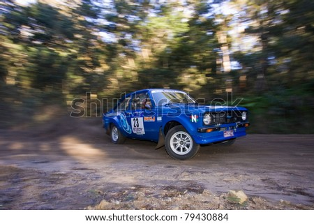 EDEN - JUNE 12: Neil Schey and Scott Middleton compete at the bega Valley Rally, June 12, 2011 in Eden, NSW, Australia. - stock photo