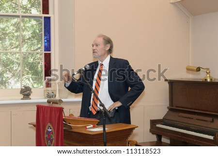 EDEN MILLS, ON - SEPTEMBER 16:  Author, editor and publisher, Doug Gibson, introduces renown novelist Alistair MacLeod at the annual Writers Festival in Eden Mills, Ontario on September 16, 2012. - stock photo