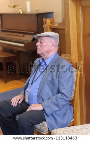 EDEN MILLS, ON - SEPTEMBER 16:  Award-winning writer, Professor Alistair MacLeod,waits to read from one of his books at the annual Writers Festival in Eden Mills, Ontario on September 16, 2012. - stock photo