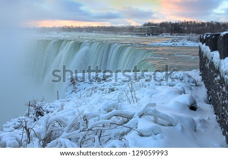 Edge of Niagara Falls in winter - stock photo