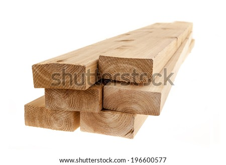 Edge of six cedar two by four wood boards on white background - stock photo