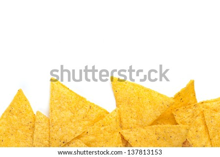 edge of tortilla chips on white background - stock photo