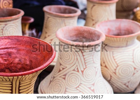 Edge put a row of pottery. - stock photo