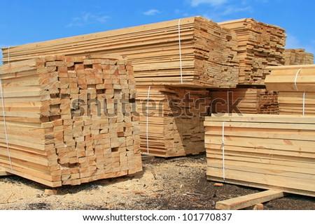 Edging board in stacks - stock photo