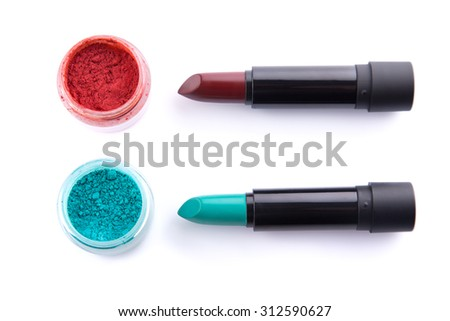 Edgy color lipsticks with matching eye shadows, top view isolated on white background  - stock photo