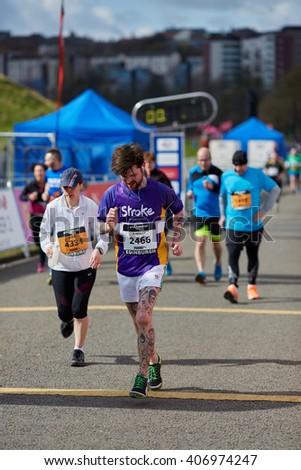 EDINBURGH â?? APRIL 17: Participants of 10 mile Great Edinburgh Run at their final stretch in Holyrood Park, April 17, 2016 in Edinburgh, UK - stock photo