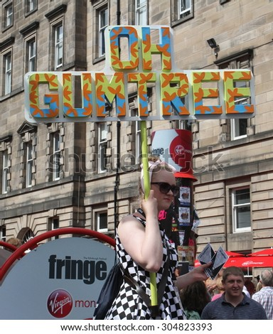 EDINBURGH - AUGUST 8: Member of Blue Suit Theatre Company publicize their show Oh Gumtree during Edinburgh Fringe Festival on August 8, 2015 in Edinburgh, Scotland - stock photo